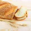 Bread with sesame and wheat ears — Stock Photo