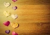 Sfondo in legno con cuori — Foto Stock