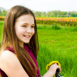 Girl with bicycle in countryside — Stock Photo #41058069