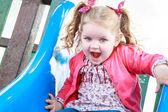 Little girl having fun on the slide — Stockfoto