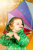 Little girl with colorful umbrella — Stock Photo