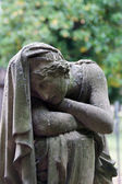 An ancient grave - a delicate Grieving — Stock Photo