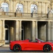 A red sports car from Maranello in front of New Castle Stuttgart - Neues Schloss Stuttgart — Foto Stock