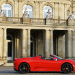 A red sports car from Maranello in front of New Castle Stuttgart - Neues Schloss Stuttgart — Stock fotografie
