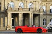 A red sports car from Maranello in front of New Castle Stuttgart - Neues Schloss Stuttgart — Stock Photo