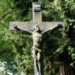 An ancient and weathered grave cross of iron. — Stock Photo