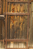 Old doors faded by sun — Stockfoto