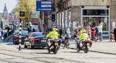 Police on motorbikes in citycenter escorting royal princess Beatrix — Stock Photo