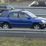 ������, ������: Hyundai Tucson driving down the road