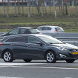 Постер, плакат: Hyundai I40 driving down the road