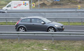 Volvo C30 driving down the road — Stock Photo