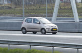 Hyundai I10 driving down the road — Stock Photo