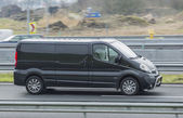 Opel Vivaro Driving down the road — Stock Photo