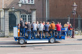 Beer bicycle trough Amsterdam — Stock Photo
