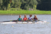 Rowing on the water as a team — Stock Photo