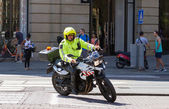 Municipal official on a motorbike on patrol in Amsterdam — Stock Photo
