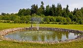 Fountains in garden — Stock Photo