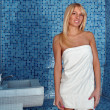 Beautiful blonde girl in steam room — Stock Photo