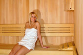 Beautiful blonde hair girl in sauna — Stock Photo