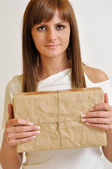 Girl with a package — Stock Photo