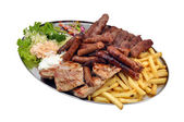 Mixed grill with salad and french fries — Stock Photo