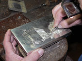 Silversmith affecting silver box — Stock Photo