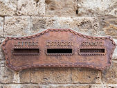 Old italian mailbox oxidized in the wall — Stock Photo