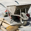 Stock Photo: Paving work wheelbarrow bucket and broom