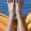 Sandy crazy woman toes on the beach — Stock Photo
