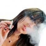 Brunette girl smoking electronic cigarette — Stock Photo #27666669