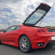 Постер, плакат: Red ferrari f430 with tailgate open