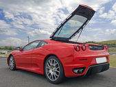 Red ferrari f430 with tailgate open — Stock Photo