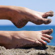 Stock Photo: Sandy crazy woman toes on the beach