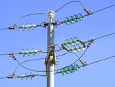 Current pole with insulators — Stock Photo