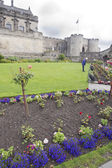Gardener at work in the park of a Scotland Castle — Stock Photo