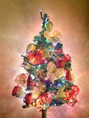 Christmas tree with garland and lights on — Stock Photo