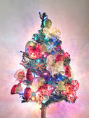 Christmas tree with garlands and lights on — Stock Photo