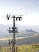 High voltage pylons spoil countryside landscape — Stock Photo