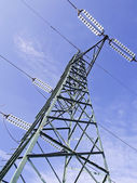 Green high voltage pylons view from above — Stockfoto