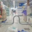 Shopping cart in a supermarket — Stock Photo #38420513