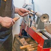 Craftsman at work  latheing wood  — Stock Photo
