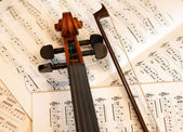 Violin bow and notes — Stock Photo