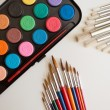 School supplies watercolor and brushes — Stock Photo