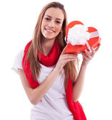 Smiling girl with gift heart — Stock Photo
