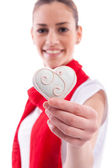 Smiling beautiful girl holding candy heart — Stock Photo