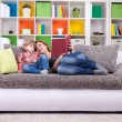 Stock Photo: Family spend time to reading book