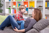 Little boy telling a story to mother — Stock Photo