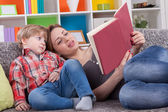 Mother and child reading a book — Stock Photo