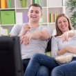 Young couple watching television — Stock Photo