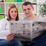 Reading newspaper — Stock Photo